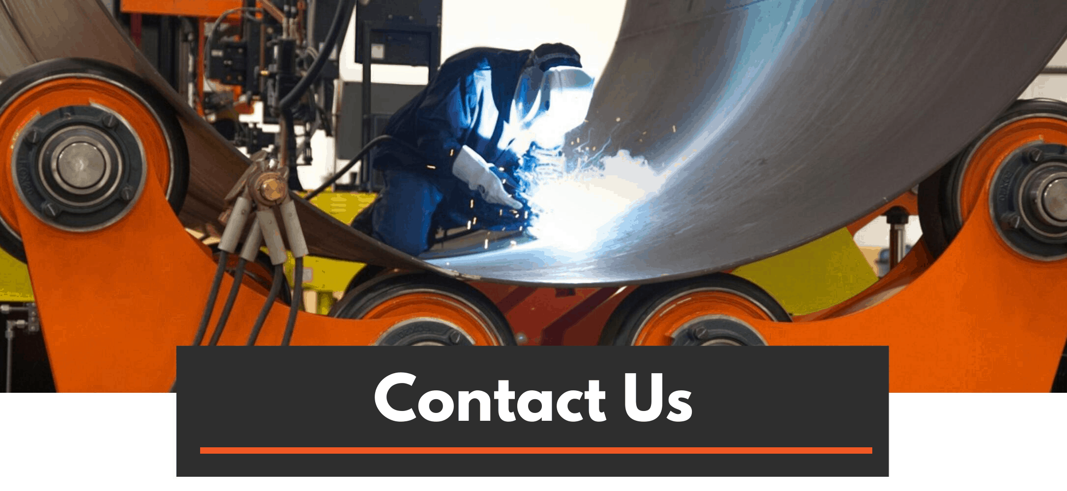 Welder performing welding inside a pipe in large weld positioning equipment